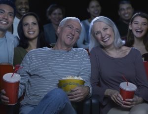 Senior couple keeping cool a the movies.