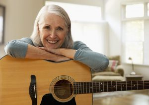Activities such as palying a musical instrument can boost brain power for seniors.
