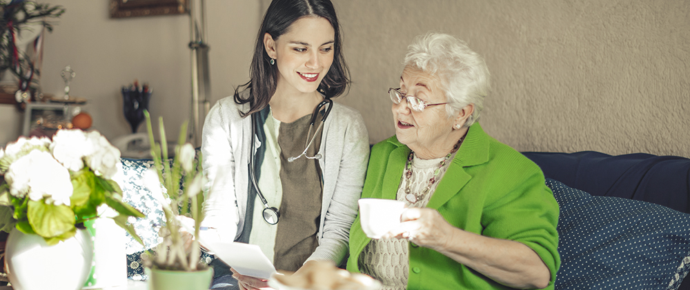 Senior Safety Tips: Social worker is visiting a senior woman at home