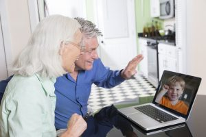 A senior couple having a video chat with their grandson