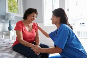 Nurse Making Home Visit To Senior woman will help you with aging in place.