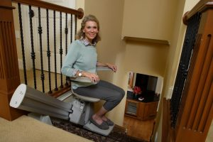 A temporary lift chair rental is installed not to touch walls or banisters.