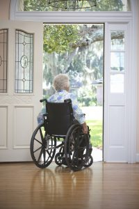 Senior Safety Tips: Elderly woman in a doorway sitting in a wheelchair