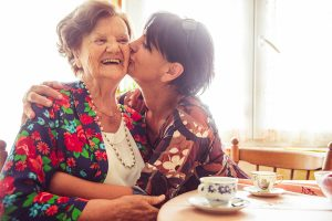 Woman Kissing Her Mother on Cheek. Does Medicare pay for stair lifts, in some cases yes.