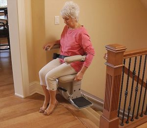 Woman on elite indoor Stairlift