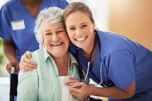 Portrait of a smiling nurse with her senior patient in nursing home