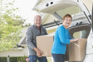 senior couple moving to a smaller place to save on expenses, downsizing.