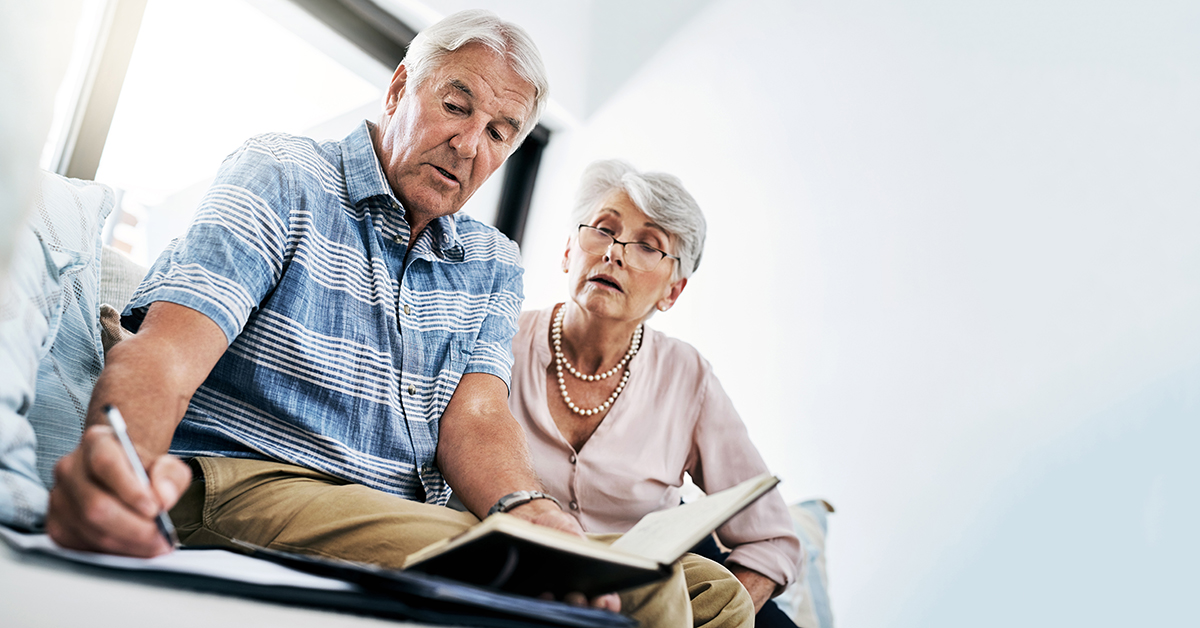 Senior couple going over finances