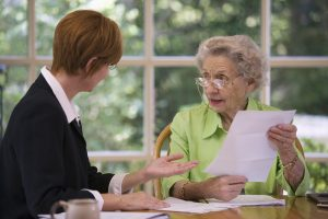 Senior woman discussing selling life insurance policy