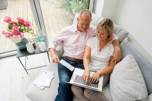 Retired seniors paying bills and planning retirement