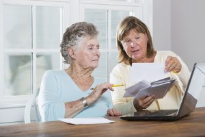 Cargiver helping senior with finances