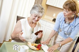 Caregiver making meal for senior