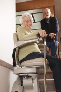 Senior on stairlift