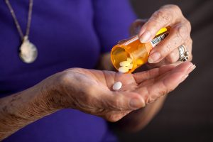 Senior woman taking prescription medication drug