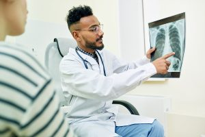 Doctor going over X-Ray with patient