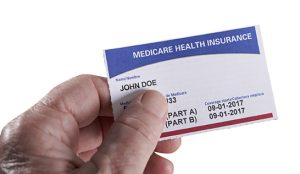 Medicare Health Insurance Card in hand