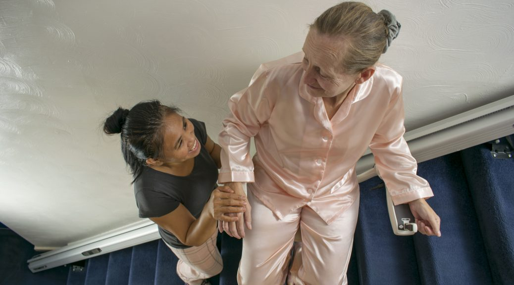 woman assisting older woman on stairlift in pennsylvania