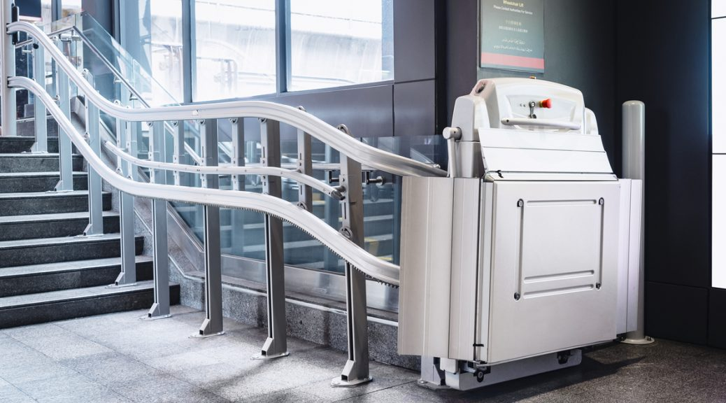 wheelchair lift by stairs in public building